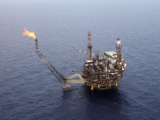 : Oil surges after OPEC and Russia agree to production cut