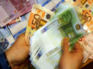 : Euro slides after ECB says it will end its 2.5 trillion euro bond-buying program