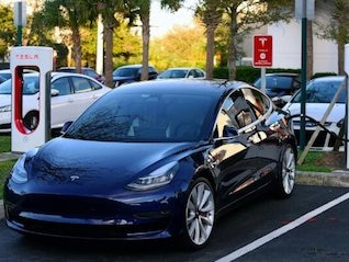 : Analyst slashes his Tesla price target, citing 'meager demand' and Model 3 'delivery issues' (TSLA)