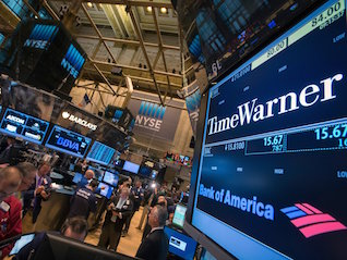 : Time Warner and AT&T fall following report the government could sue to block their merger (T, TWX)